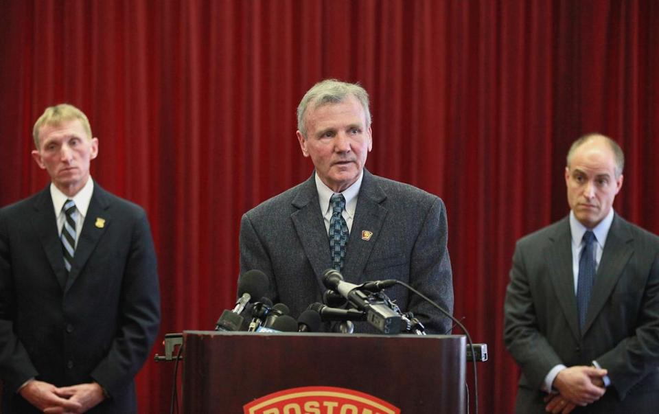 Boston Fire Commissioner John Hasson, flanked by Police Commissioner William Evans (left) and Assistant District Attorney Edmond Zabin spoke to reporters.